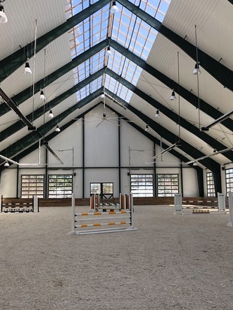An indoor jumping arena with our FSGeoTEX geotextile footing