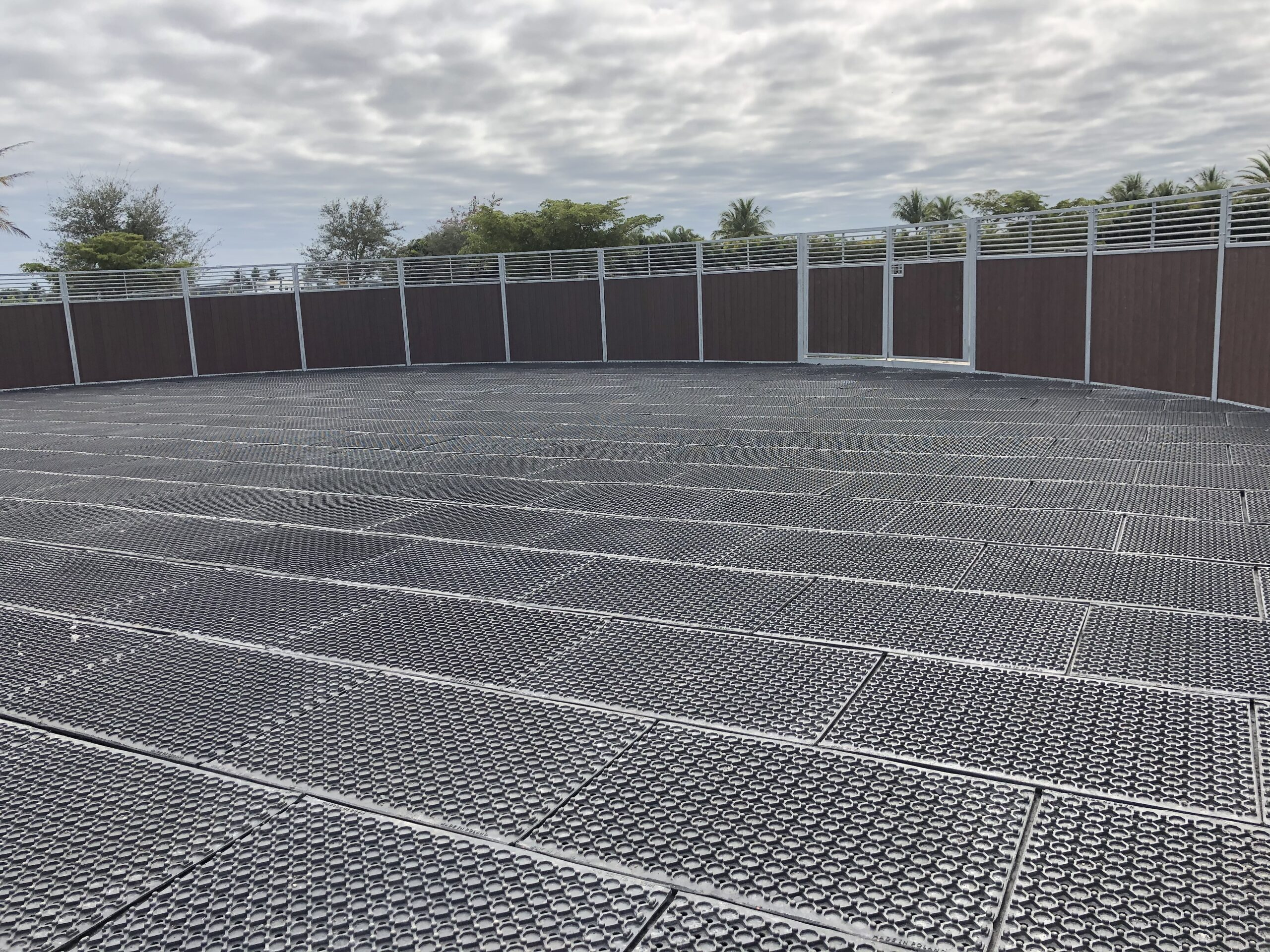 Arena base mats laid out in a round pen